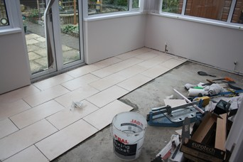 during the laying of the floor tiles